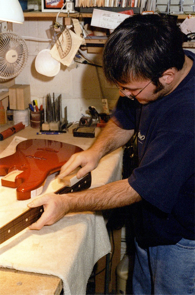 Joey Schultz works on a fingerboard edge